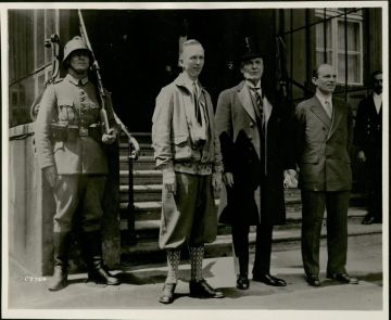 Clarence Chamberlin (left) and Mr. Charles Levine (right) leaving the President's Palace in Berlin, Germany, with Mr. Jacob Gould Schurmann, the American Ambassador on September 6, 1927
