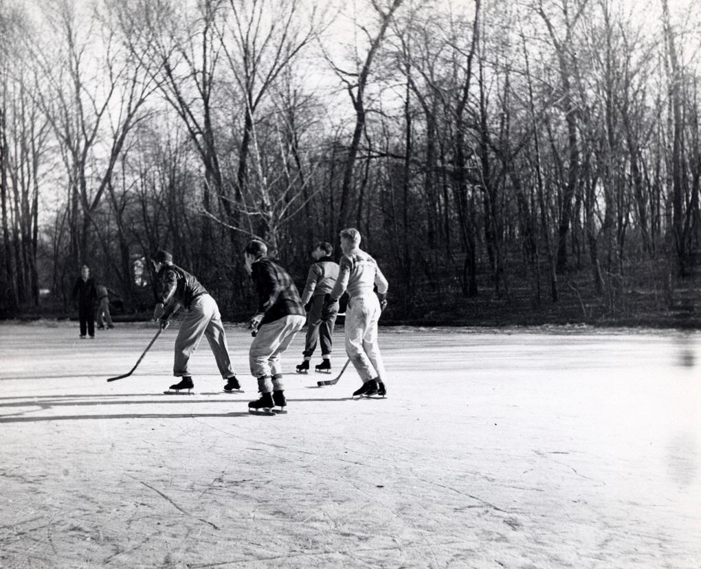 Students playing hockey on Lake LaVerne