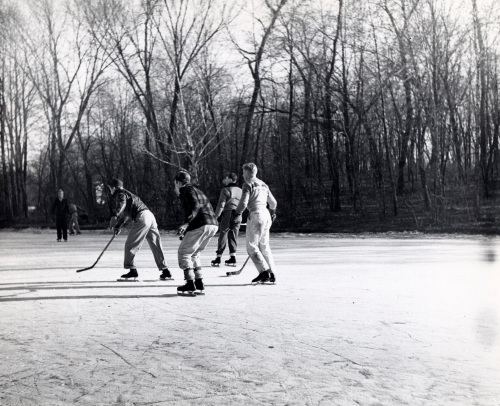 Students playing hockey on Lake LaVerne