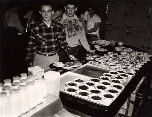 Photograph of men waiting in line in Friley Hall's cafeteria at Iowa State University.