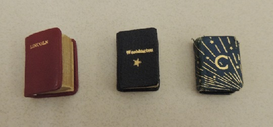 Three miniature books: Addresses of Abraham Lincoln; Washington: His Farewell Address, and Excerpts from the Autobiography of Calvin Coolidge.