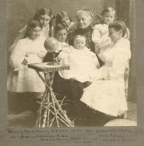 Mary Newbury Adams, surrounded by seven grandchildren.