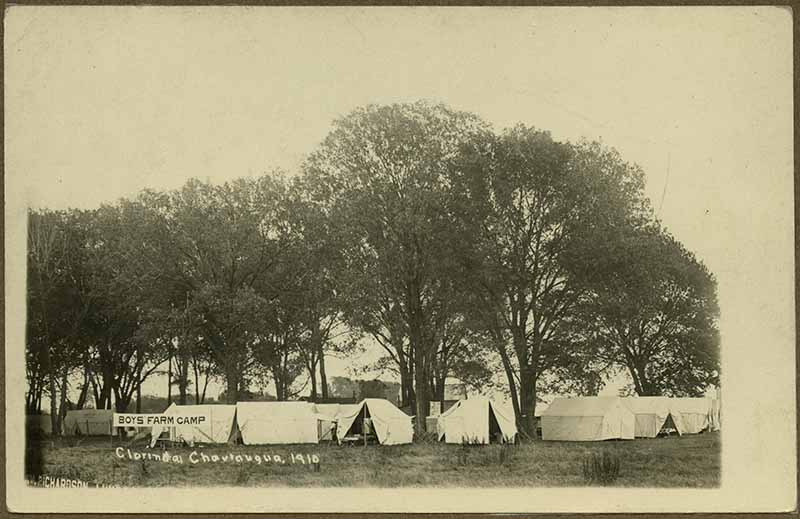 Tents among trees at the Boys Farm Camp.