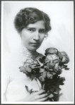 Portrait of Jessie Field Shambaugh as a young woman, holding a bouquet of flowers.