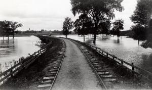 Dinkey tracks between Ames and campus with flood waters, undated.