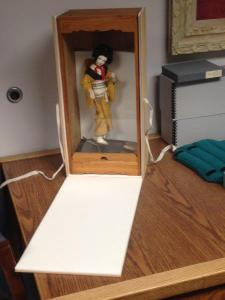 A box made to keep this geisha doll and her enclosure safe.