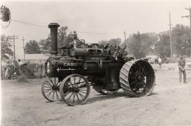 A small Case tractor with steel wheels, undated