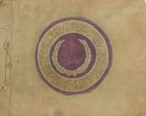 "Cover of Philip McConnell's scrapbook containing his college seal. Circling text reads ""Iowa State College of Agriculture and Mechanic Arts."" Center text reads ""Science with Practice."" RS 21/7/260, box 1."