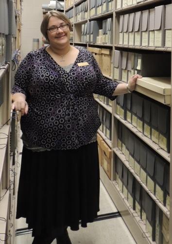 Kim standing amongst collections