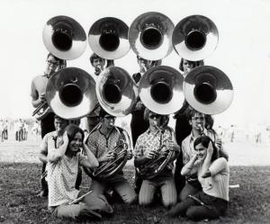 "Sousaphone and piccolo players from the Iowa State University Cyclone Football ""Varsity"" Marching Band (ISUCF'V'MB), circa 1970s. RS 13/17/3"