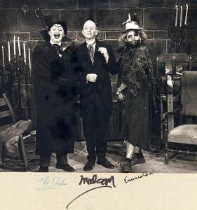 """A signed photo of The Duke of Desmodas (Jim """"Red"""" Varnum), Malcom the Butler (Ed Weiss), and Esmerelda (actor unknown) of Gravesend Manor, undated. (RS #?)"""