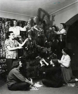 Members of Alpha Delta Phi sorority decorating their Christmas tree, 1953.