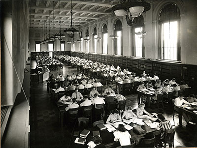 Students hard at work in the library reading room, circa 1940. Photograph Collection box 146.