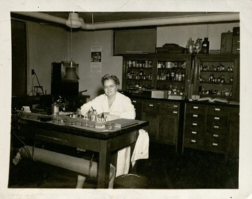 Undated photograph of Margaret Sloss at work in her lab. Box 4, Folder 9.