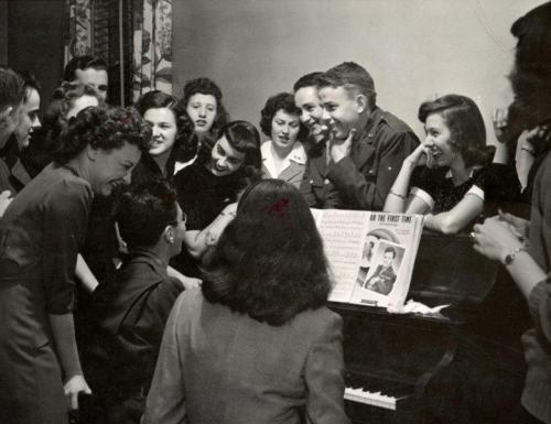 Students gathered around a piano, 1944. [add collection/location]