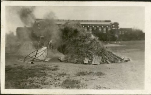 Photograph of a large freshman beanie replica burning in the bonfire during the Moving Up Ceremony, 1926. University Photograph Collection box 1702.