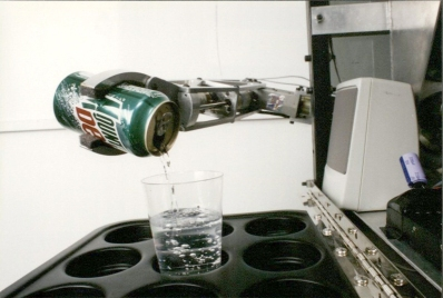 Cybot pouring water from a Mountain Dew can. (RS 11/1/8 box 10, folder 28)