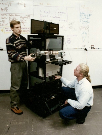 Two students calibrate CyBot. (Engineering Communications, RS 11/1/8)