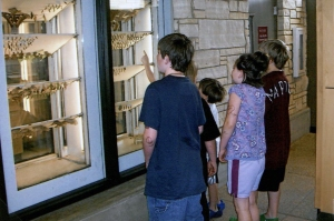 Children visiting the pupae in the butterfly wing. (RS 5/7/3/0/5 box 2, folder 5)