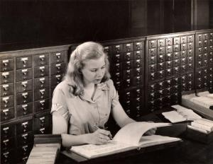 A student using the card catalog, 1948. [location]