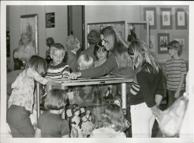 Children exploring the exhibit of the Doll Collection at Brunnier Art Museum, Iowa State University. University Photograph Collection, RS 5/8/A,D, Box 433.