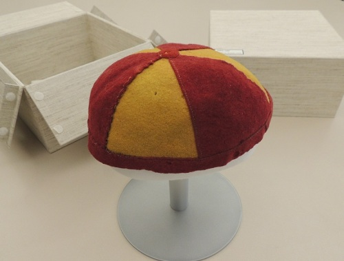 Freshman beanie belonging to Robert W. Breckenridge, circa 1918. From University Archives Artifact Collection, 2002-189. It even has it's own fancy box and hat stand!