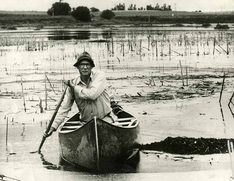 Paul Errinton, research professor of zoology at Iowa State University from 1932 to 1962, in a canoe. University Photographs 13/25/A, box 1235.
