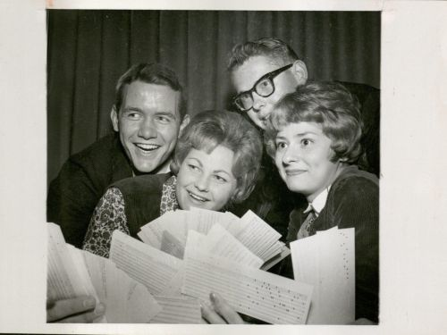 Students holding punch cards for the IBM Computer Dance in 1963.