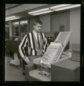 A card sorter like the one shown here in the Iowa State Computation Center would have been used to sort the punch cards for the dance. From the University Photographs Collection, box 439.