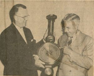 John C. Eldredge (left) being presented a weather instrument by Pete Oleson (right), President of the Popcorn Processors Association. Ames Daily Tribune, 1955. RS 9/9/51, Box 2, Folder 11.