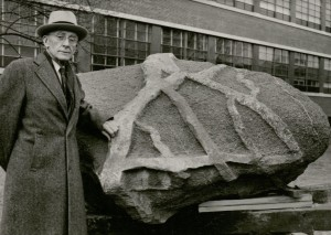 Charles S. Gwynne in front of the boulder. undated. (University photographs, RS 13/8, box 1057)