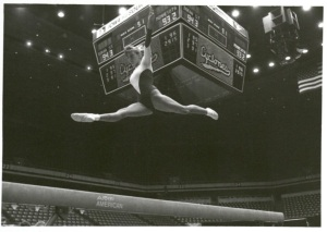 ISU gymnast on the balance beam circa 1991 (University Photographs box 2018)