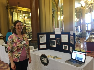 Amy Bishop, rare books and manuscript curator, at our exhibit table in the Iowa State Capitol's rotunda for Silos & Smokestacks Legislative Showcase.