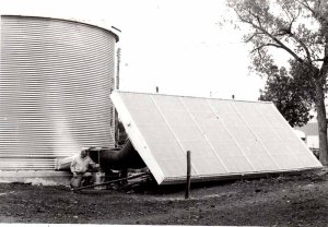 Portable solar collector has been attached to a grain bin for grain drying, circa 1979.