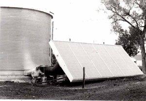 Portable solar collector has been attached to a grain bin for grain drying, circa 1979.