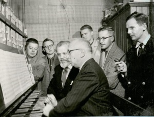 Taken at a Carillon Guild meeting held at ISU, November 1959. From left, seated: Percival Price, Univ. of MIchigan; Ira Schroeder, ISU. Standing: Ronald Barnes, Univ. of Kansas; Dean Robinson, Mayo Clinic, Rochester, MN; Charles Ward, Rueter Oregon Co., Lawrence, KS; Milford Myhre, Culver Military Academy; and C.G.B. Garrett, St. Peter's Episcopal Church, Morristown, NJ. (University Photographs box 132)