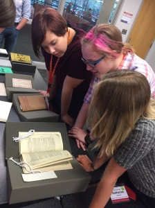 OPPTAG students viewing cookbook from Rare Book Collection