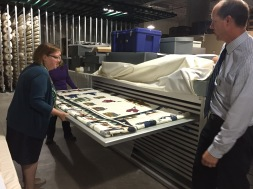 Kay Coats, Museum Collections Coordinator; Jodi Evans, Museum Registrar, and Leo Landis, State Curator show us a quilt by Mary Barton (photo by Rachel Seale)