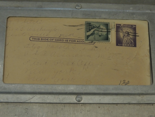 Close-up of postcard on laundry mailer