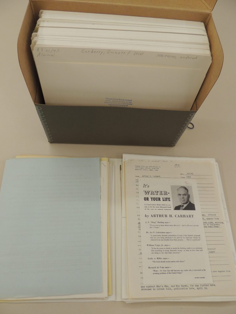 Arthur Carhart's file, he graduated from Iowa State in 1916. File folder open and sitting in front of document box.