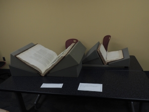 Two of our rare books propped up in book cradles (Photo b Rachel Seale)
