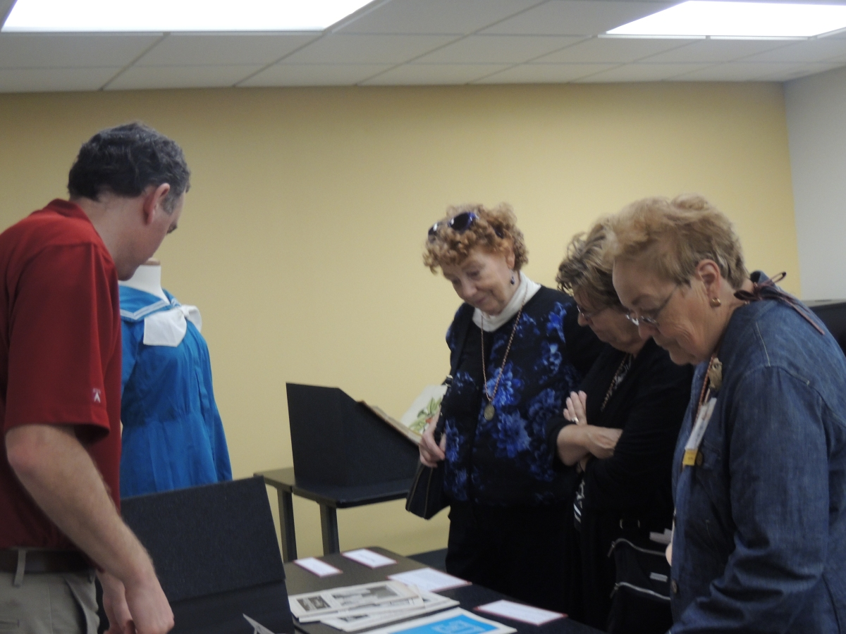 Former alumni visiting with Brad Kuennan, University Archivist, at student publications & 4-H table