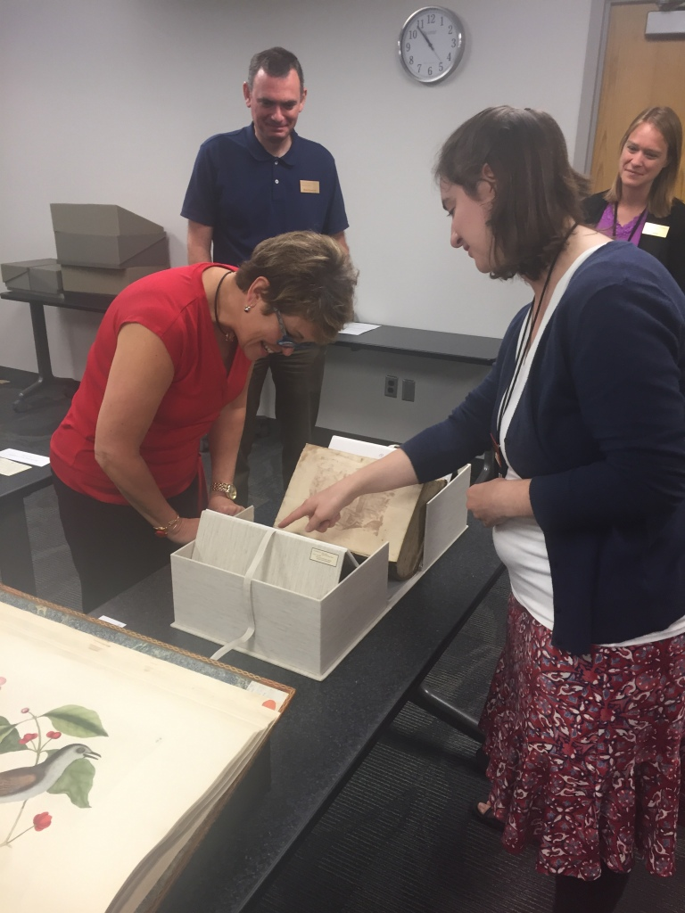 Heather Botine, Associate Director for Constituent Engagement, looks at our oldest book with Amy Bishop, Rare Book and Manuscripts Archivist. University Archivist, Brad Kuennen, and Collections Archivist, Laura Sullivan, in background.