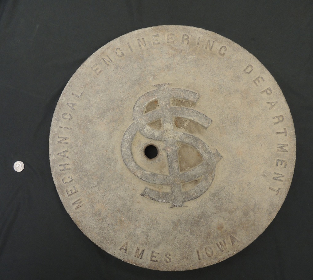 "Top view of manhole cover, text on cover ""Mechanical Engineering Department, Ames, Iowa"""