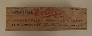 "Wooden cheese box 9.25 inches wide, text on box ""2 Pounds net weight, Iowa State College, pasteurized process cheese, Manufactured by Dairy Industry dept., Iowa State College, Ames, Iowa."""