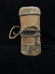 Kenyan Fat Pot, wide cylindrical object with a lid and a handle.