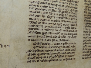 Close up of the manuscript inside the front cover of the book.