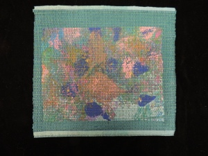 "Woven picture entitled ""Bluebirds Herald Spring"" by Shirley Held (Artifact 2009-069.037)"