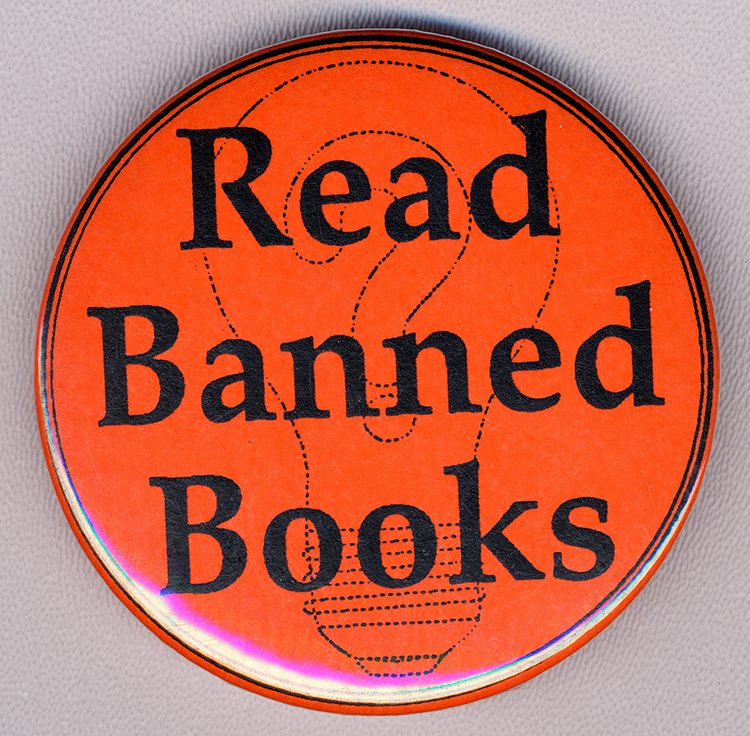"Orange button, black text ""Read Banned Books"" over image of light bulb"