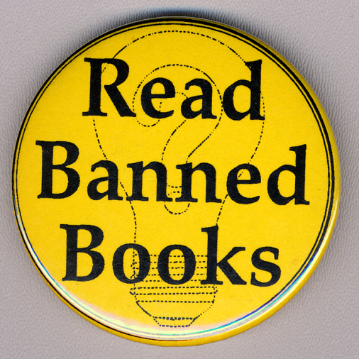 "Yellow button, black text ""Read Banned Books"" over image of light bulb"